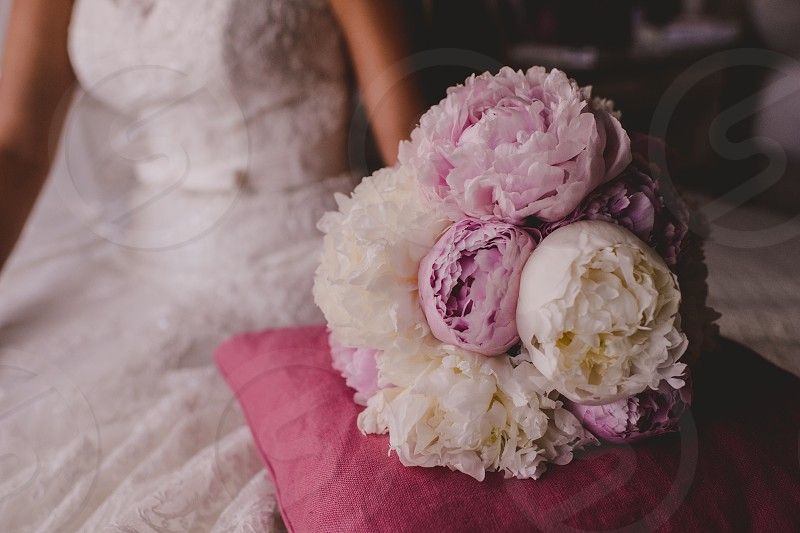 Wedding Bride bouquet made with peonies in soft pink and purple colors photo