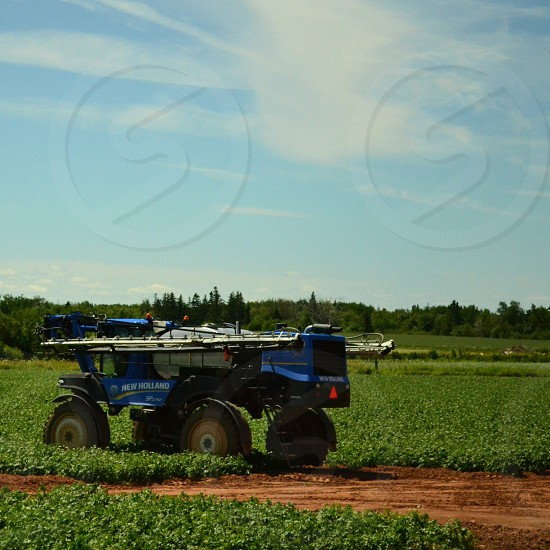 blue new holland harvester photo