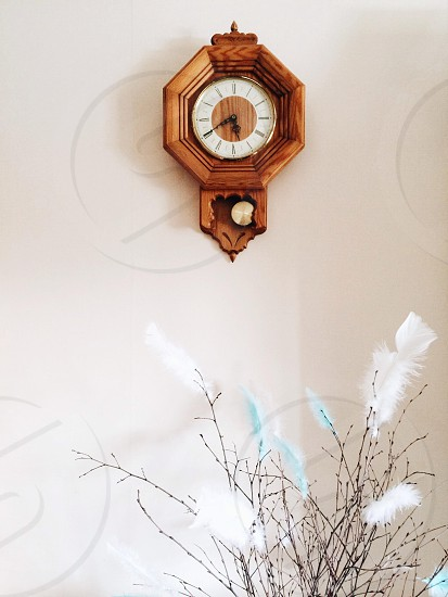brown wooden wall clock 5:40 photo