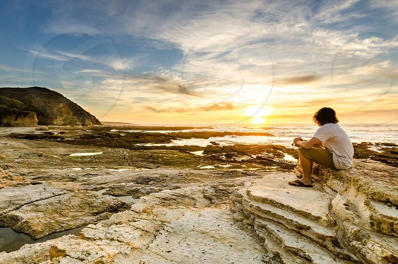 Sunset beach contemplative vibrant ocean west coast California coast breath taking  photo