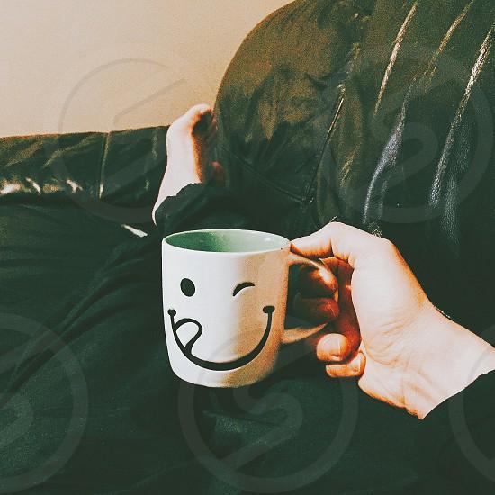 white ceramic mug with smiley print photo