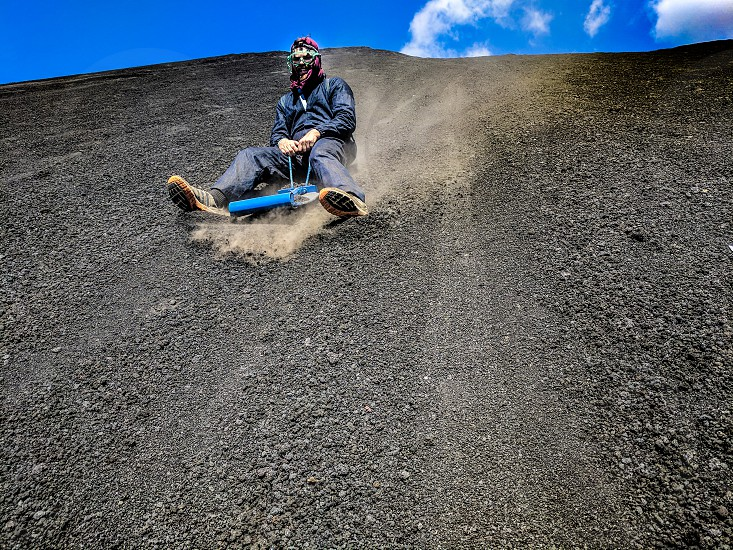 sliding down a volcano in Nicaragua! photo