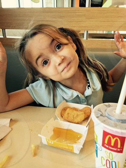 My daughter being funny on our lunch date at McDonalds.  photo