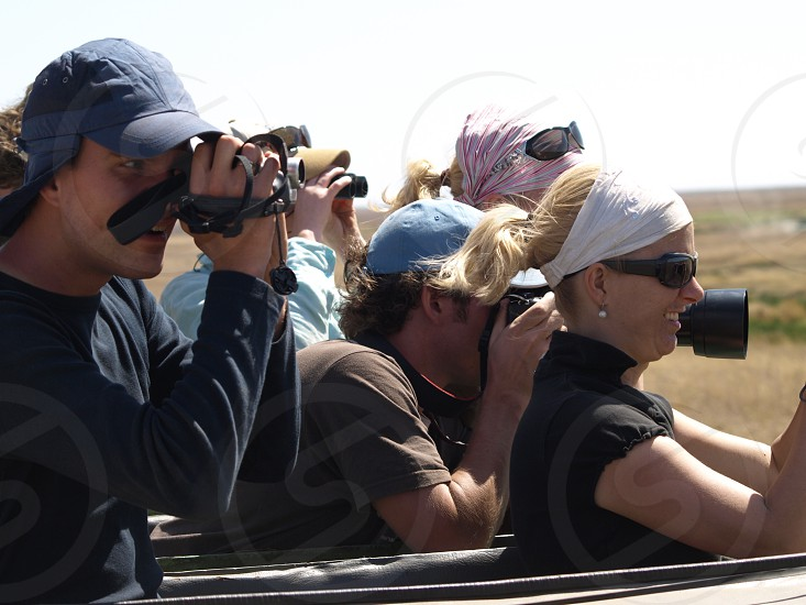 five people holding cameras photo