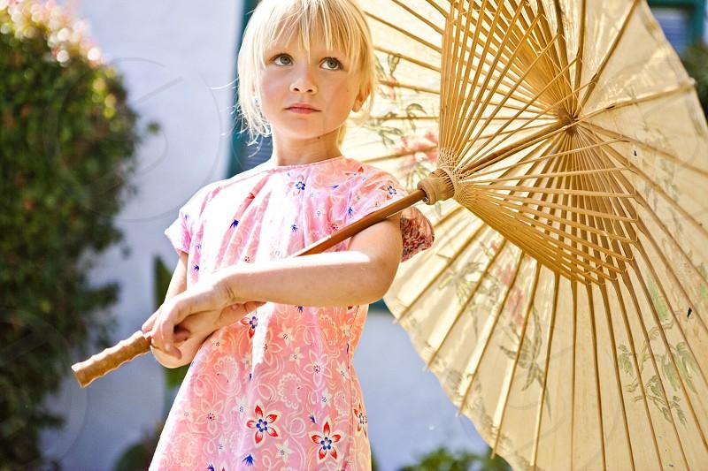 Children pink outside umbrella portrait summer  photo