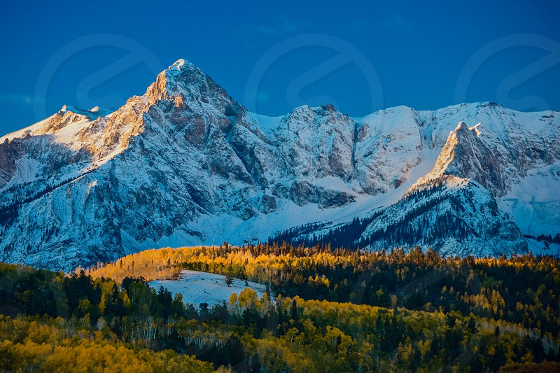 Mount Sneffels sunrise autum colors and  blue sky between  Ridgway Colorado and Telluride Colorado September 2005 photo