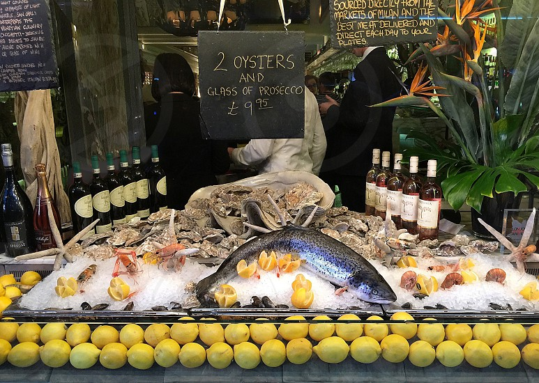 Restaurant window exterior fish lemon French cuisine high class expensive enticing attractive food eat eating eatery photo