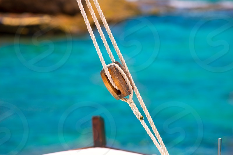 Boat classic pulley from sailboat in Mediterranean at Balearic Islands photo