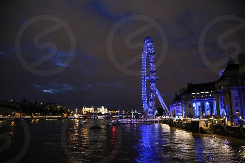 London Londoneye fun ride Thames  river water night nighttime  nightlife in London  south bank  South Bank view  city Capitol  English England  photo