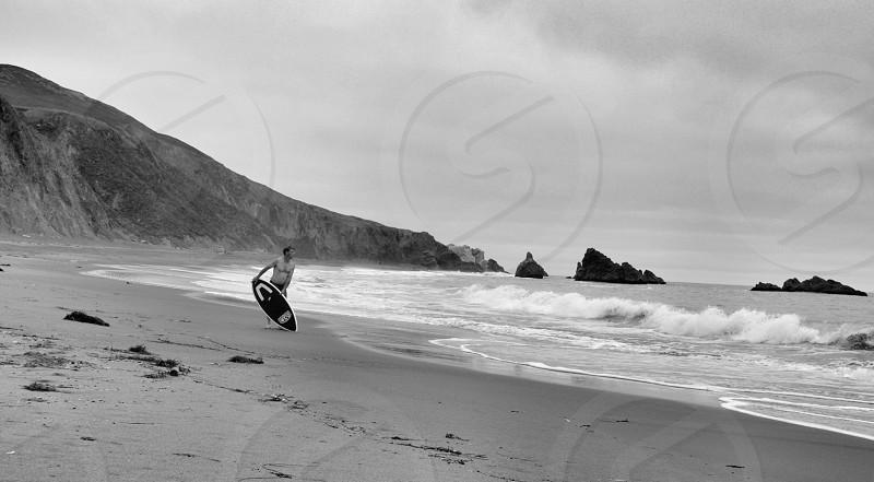 Skimboard on the California Coast. photo
