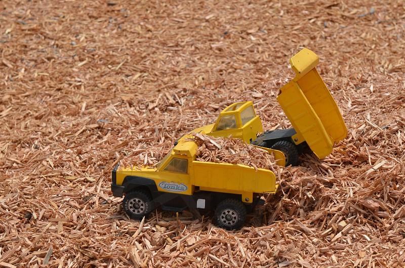 Toy dump trucks bark photo