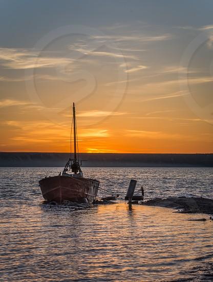 Old abandoned boat at sunset. Drying salt lake near Odessa Ukraine photo