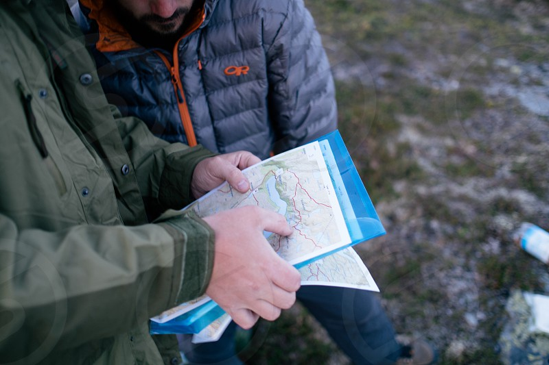 two men looking at a map photo