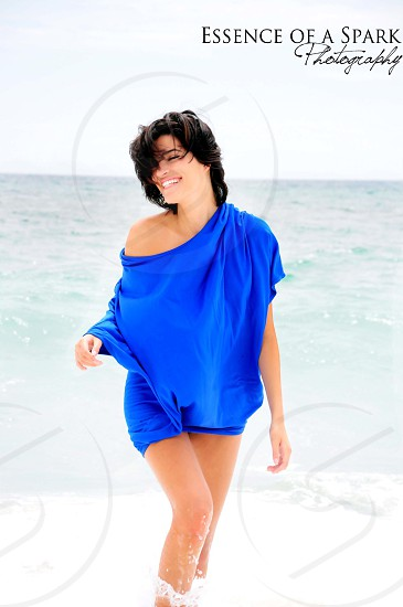 women's blue scoop-neck shirt with text overlay photo