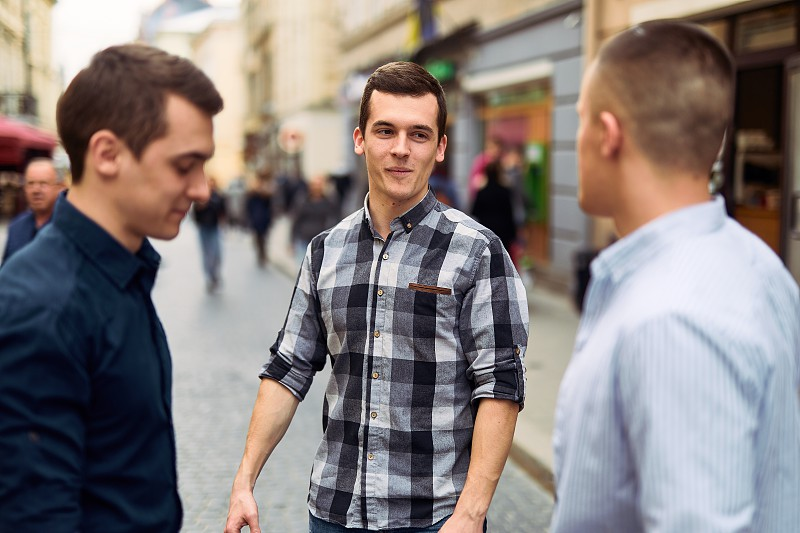 Three man talk on the street about business photo