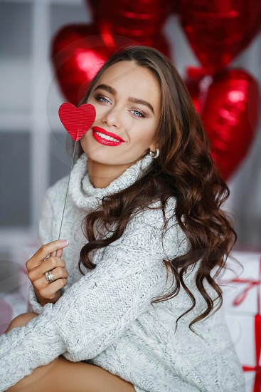 Fashion girl model with red ballons. photo