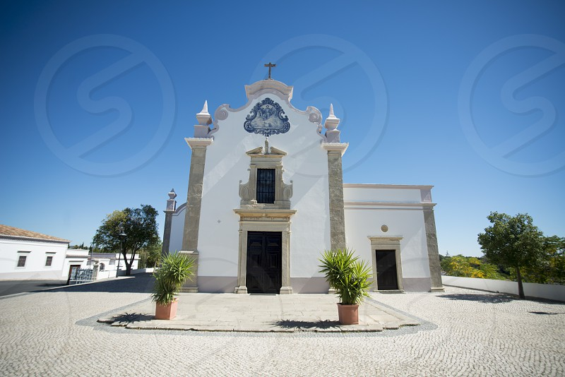 the Church Igreja de Sao Lourenco in the old town of Almancil at the east Algarve in the south of Portugal in Europe. photo