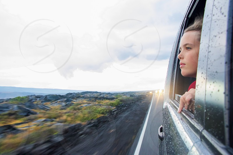 driving through storm travel wanderlust head out window wind on your face girl passenger raindrops protection photo