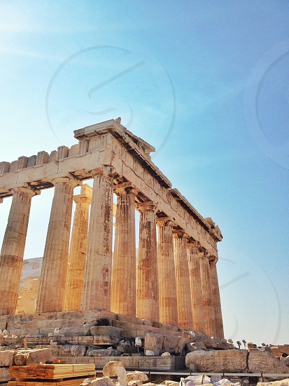 An unusually tourist-less view of the Parthenon on the Acropolis of Athens Greece in the sun.  photo