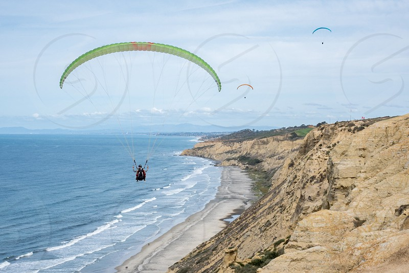 Paragliding ocean cliff California photo