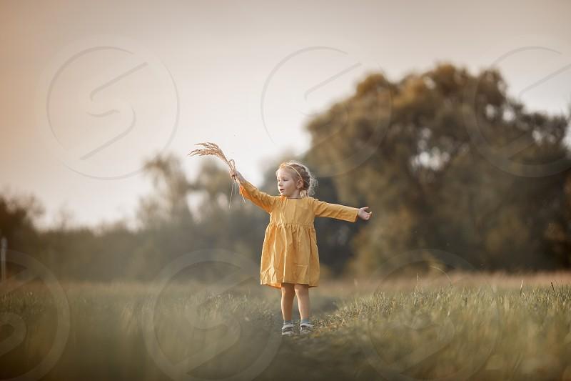 Little girl in yellow dress outdoor portrait  photo
