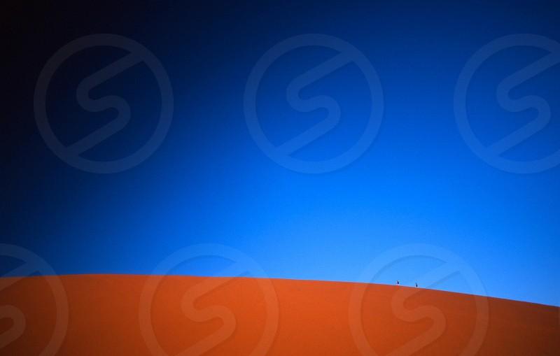 sand dune taken daytime photo