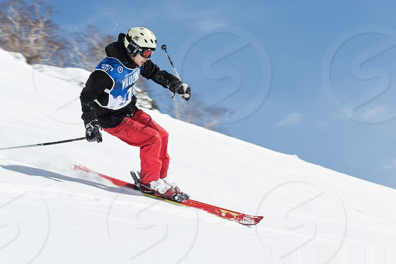 "KAMCHATKA RUSSIA - MARCH 9 2014: Skier rides steep mountains. Competitions freeride skiers and snowboarders ""Kamchatka Freeride Open Cup"". Russia Far East Kamchatka Peninsula. photo"