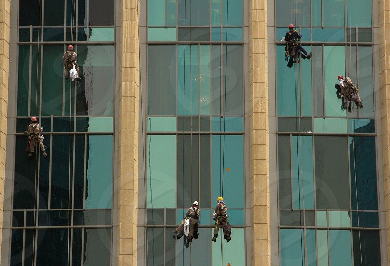 Window cleaners on a high rise. photo