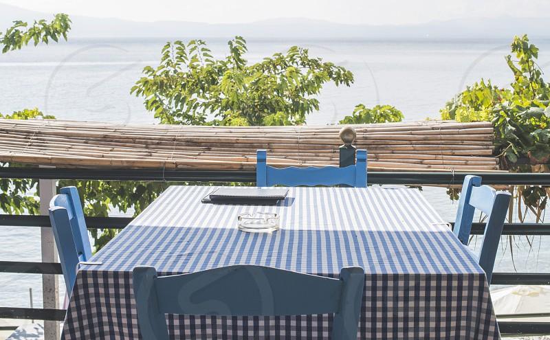 Chair in greek taverna on a beach. Greece photo