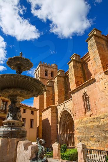 Mora de Rubielos Teruel church of XV century with fountain in Spain photo