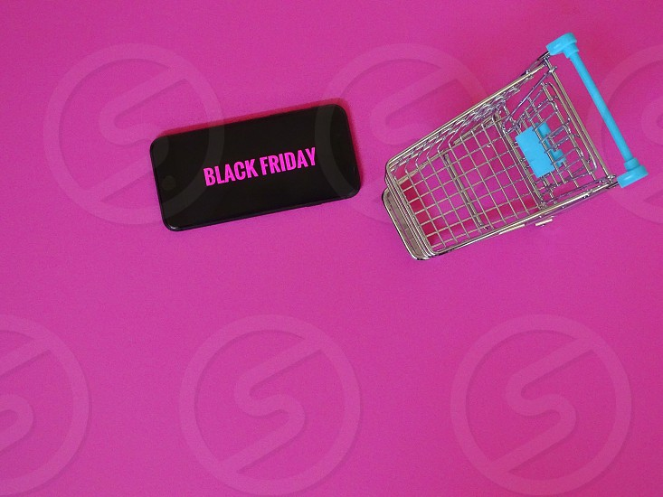 Black friday shopping cart sale sales pink background shopping mini deal pink  photo