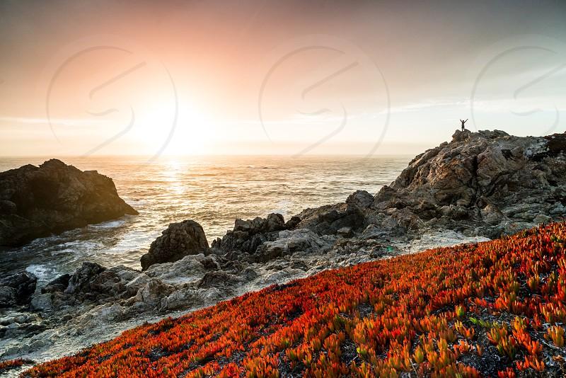 sunset california coast highway 1 big sur ocean sun salute photo