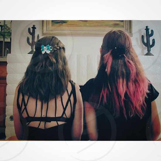 Older sister does her and her little sister's hair photo