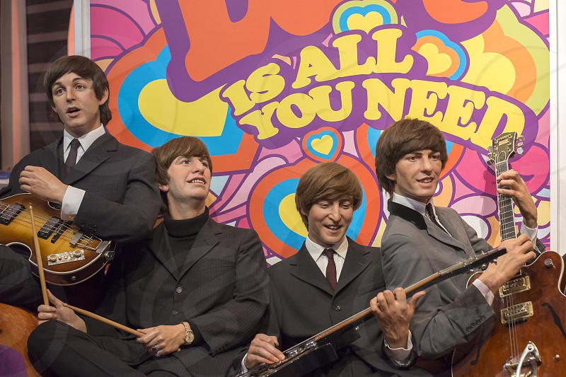 Wax figures of The Beatles at Madame Tussauds in London England. photo