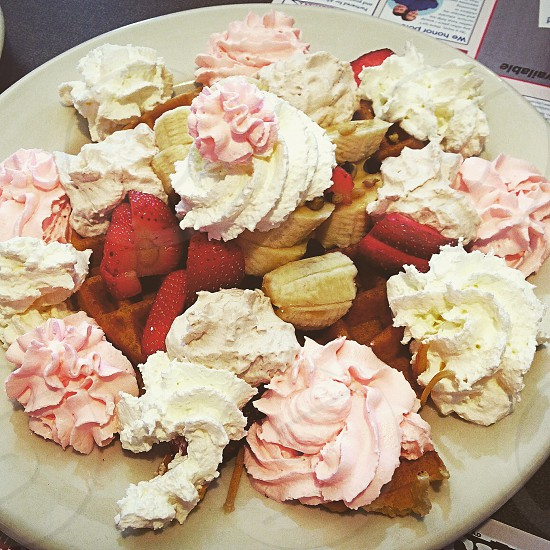 Foodie finds - that is one incredible waffle! Foodie food waffle bananas whip cream strawberries delicious eat share breakfast  photo