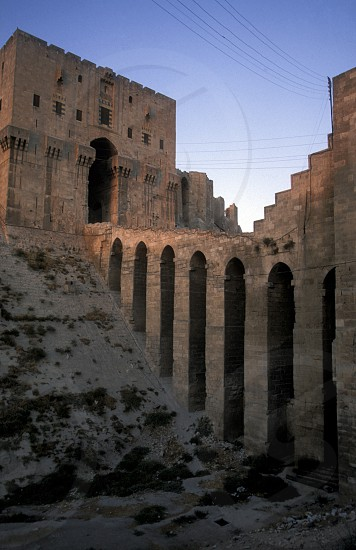 the Citadel in the old town in the city of Aleppo in Syria in the middle east photo