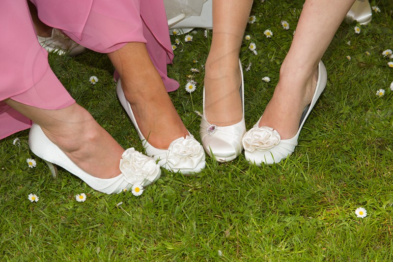 woman in white flats with flower accent photo