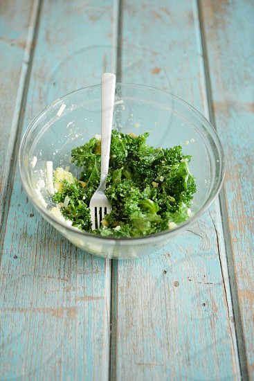 kale salad bowl glass fork table food blue table wood vintage natural light  photo