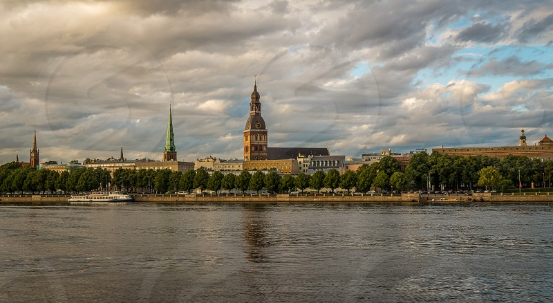 View of the old town of Riga from the river side in a summer evening photo