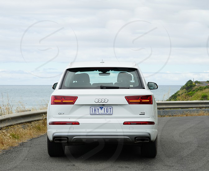 Car driving the Great Ocean Road west of Melbourne Australia photo