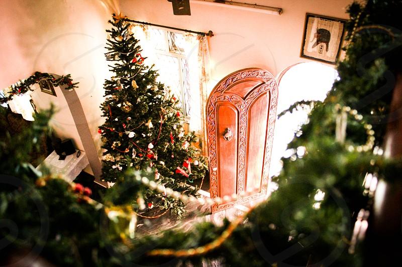 running downstairs on Christmas morning Christmas staircase big  tree door santa light bright photo
