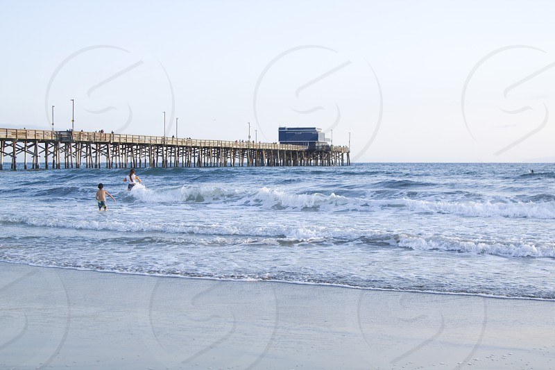 Newport Pier/Mom and Kid Playing in the Ocean - 2 photo