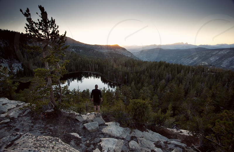 A Hiker overlooking Lost Keys lake in the Sierra Nevada Mountain backcountry photo