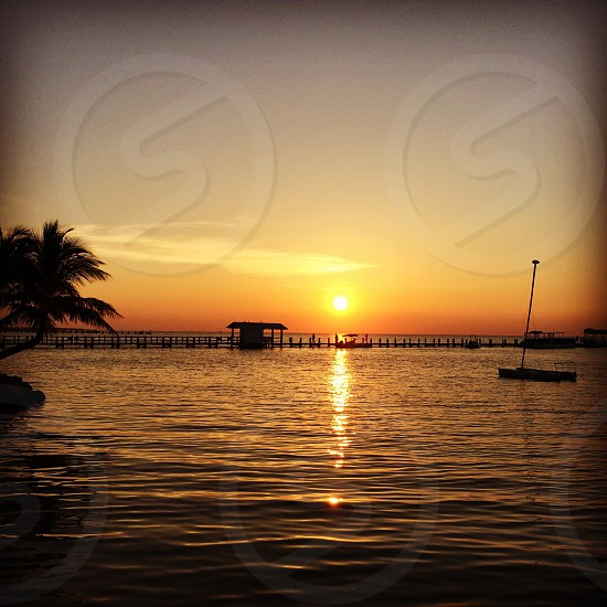 #Islamorada #sunrise. This was worth getting up for. #beautiful #sun #sea #water #sailboat #dock #reflection photo