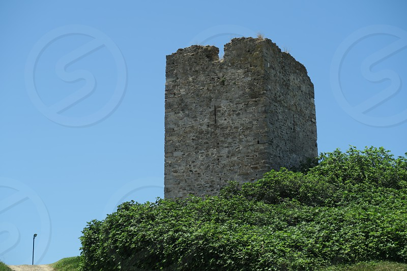 Sani Tower Halkidiki Greece. Remains of tower standing on Sani Hill above the luxury resort is also known as Stavronikita tower. photo