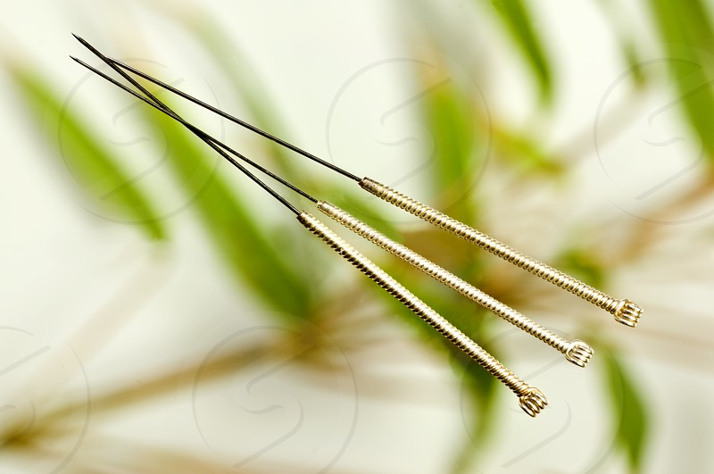 acupuncture needles with bamboo background photo