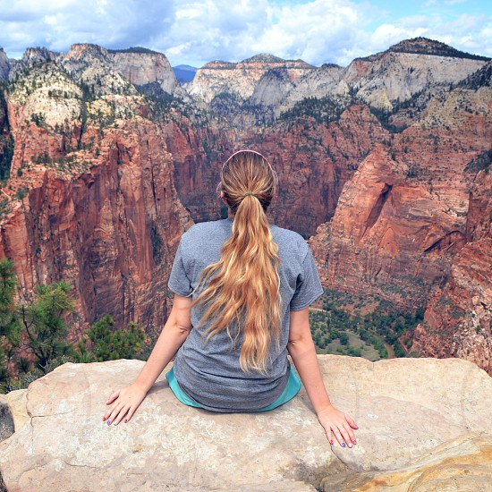 Girl hiker enjoying the view at Angel's Landing in Utah photo