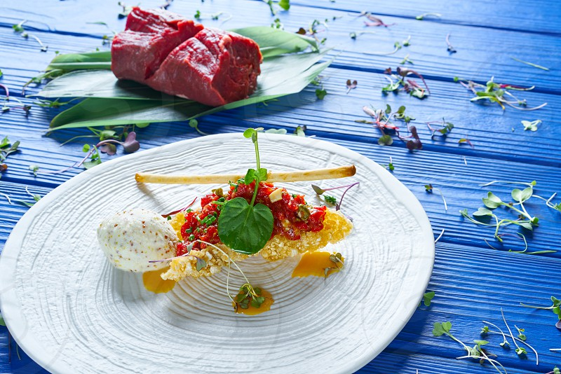 Steak Tartare with mustard ice-cream and airbag starter Tartar recipe photo