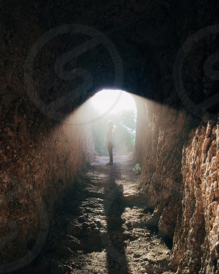 woman standing in the cave photo