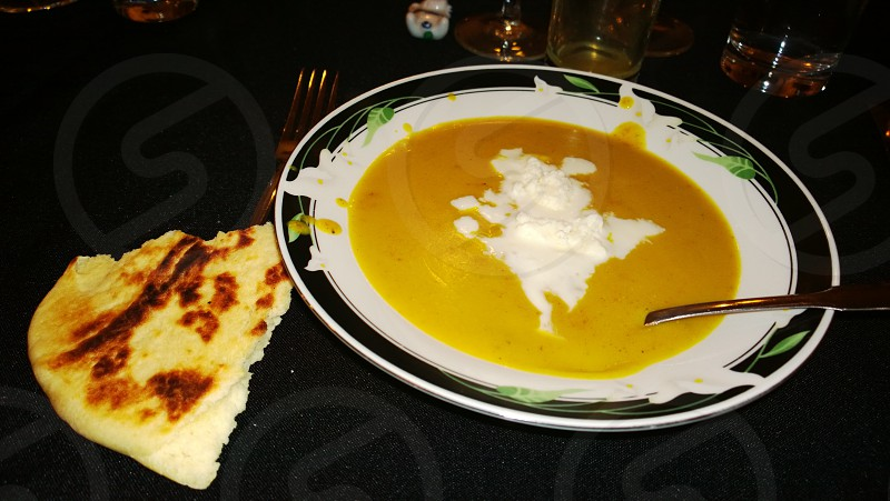 Pureed lentil soup with shrikhand ice cream.  Naan. photo
